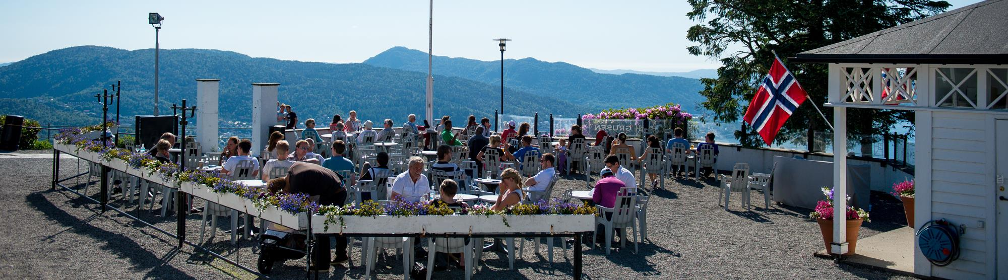 Enjoy local cuisine and a panoramic view of Bergen at Mount Fløyen.